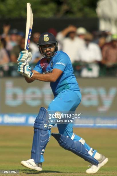 India's Rohit Sharma plays a shot during the Twenty20 International cricket match between Ireland and India at Malahide cricket club in Dublin on...