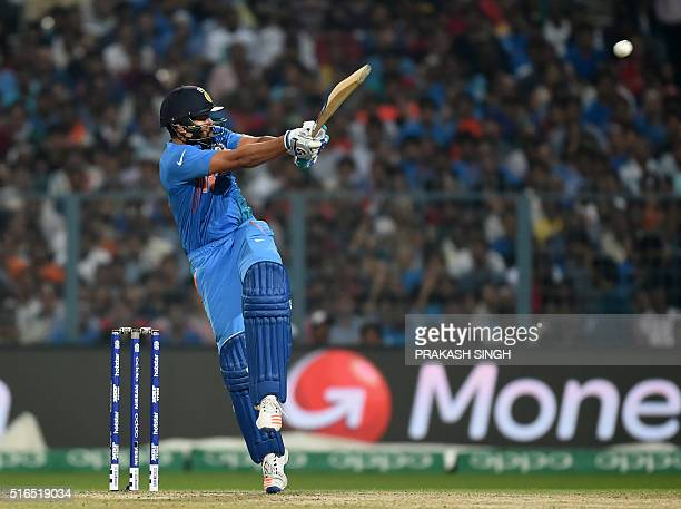 India's Rohit Sharma plays a shot during the World T20 cricket tournament match between India and Pakistan at The Eden Gardens Cricket Stadium in...