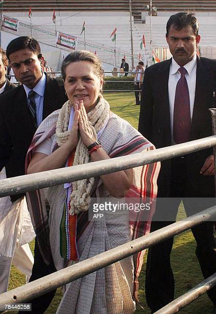 India's ruling Congress party President Sonia Gandhi greets Congress supporters following a public meeting at Sardar Patel stadium in Ahmedabad 13...