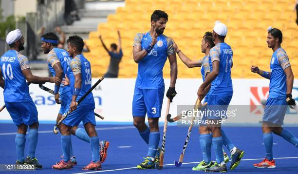 India's Rupinder Pal Singh celebrates with teammates after scoring a goal during the men's hockey pool A match between India and Hong Kong at the...