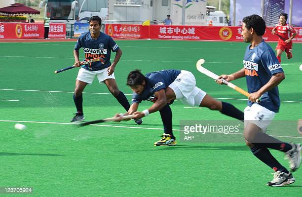 India's Rupinder Pal Singh takes a shot at Japan's goal during their match in the first Asian Men's Hockey Championship in Ordos northern China's...