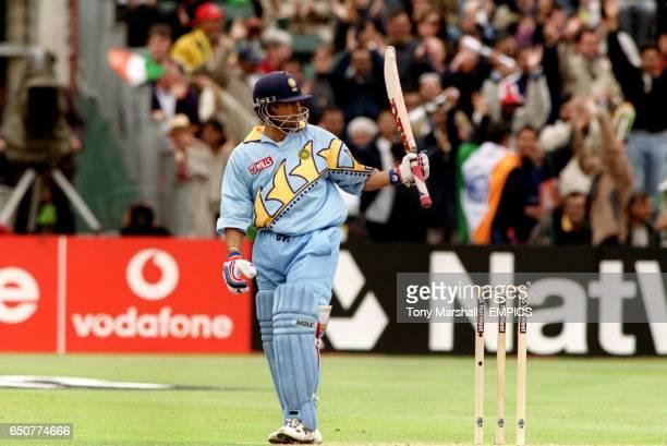 India's Sachin Tendulkar celebrates his half century