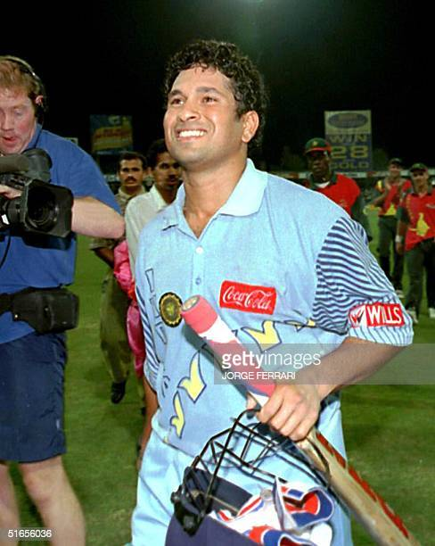 India's Sachin Tendulkar enjoys a moment of glory after leading his team to victory at the Coca Cola Trophy in Sharjah 13 November India beat...
