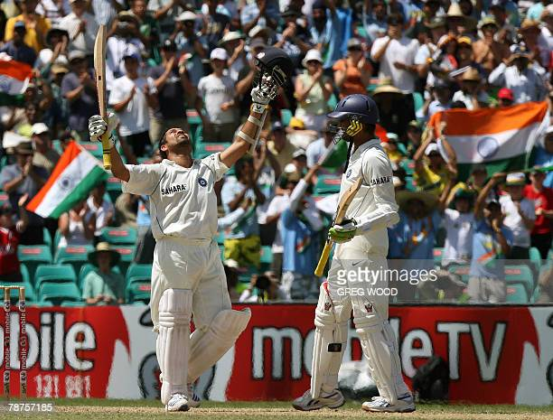 India's Sachin Tendulkar with teammate Harbhajan Singh looks skyward after reaching his century on day three of the second test match at the Sydney...