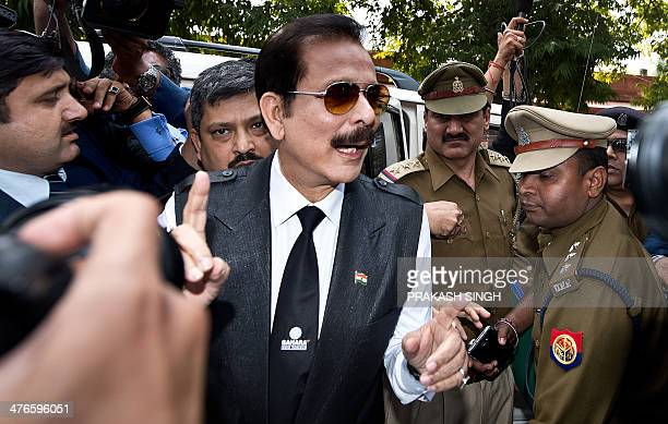 India's Sahara group chairman Subrata Roy speaks to the media as he arrives at the Supreme Court in New Delhi on March 4 2014 Black ink was thrown on...