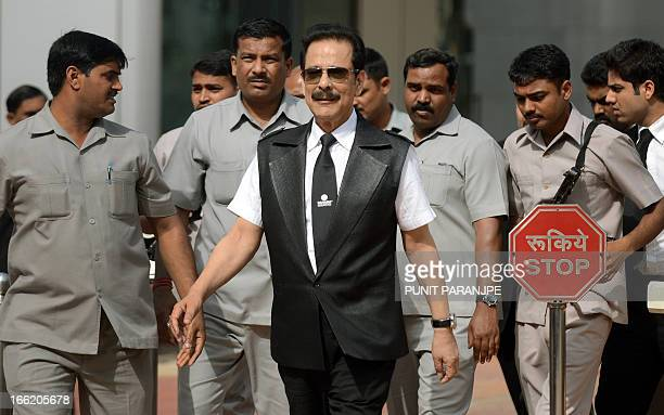 India's Sahara group's chairman Subrata Roy surrounded by bodyguards leaves the Securities and Exchange Board of India head office in Mumbai on April...