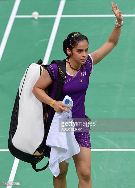 India's Saina Nehwal acknowledges the crowds applause after winning the bronze medal against China's Wang Xin in their bronze medal women's singles...