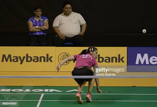 India's Saina Nehwal eyes a return against Yao Xue of China during their women's singles match at the 2015 Malaysia Open badminton championship in...