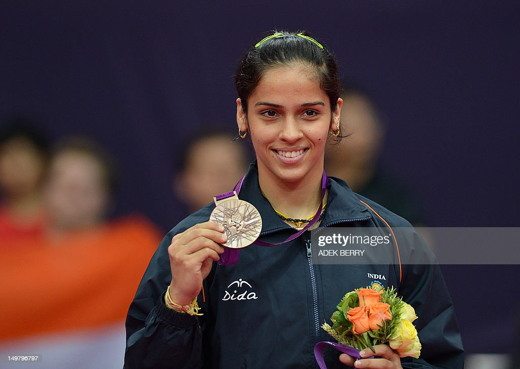 India's Saina Nehwal poses with her bron : News Photo
