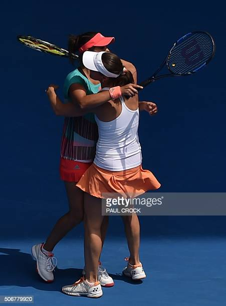 India's Sania Mirza and Switzerland's Martina Hingis celebrate during their women's doubles match against Germany's AnnaLena Groenefeld and Coco...