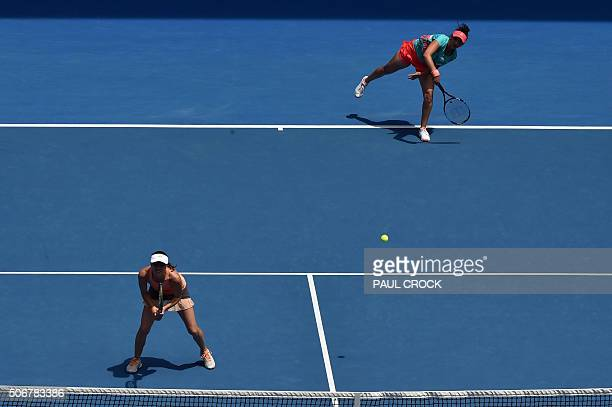 India's Sania Mirza and Switzerland's Martina Hingis compete during their women's doubles match against Germany's AnnaLena Groenefeld and Coco...