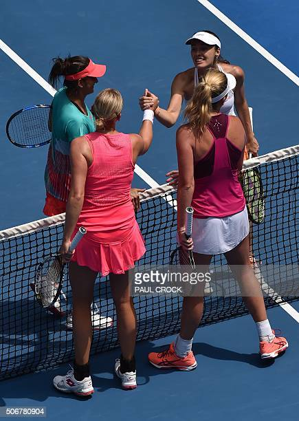 India's Sania Mirza and Switzerland's Martina Hingis shake hands with Germany's Anna-Lena Groenefeld and Coco Vandeweghe of the US after winning...