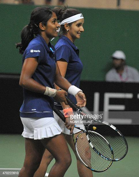 India's Sania Mirza and teammate Prarthana GThombare celebrate after winning the match against Philippines's players Katharina Lehnert and Anna...