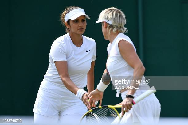 India's Sania Mirza reacts during her women's doubles first round match with on the fourth day of the 2021 Wimbledon Championships at The All England...