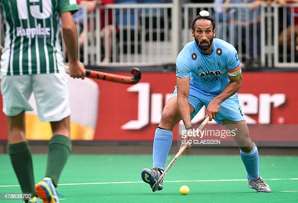 India's Sardar Singh controls the ball during the field hockey match between Pakistan and India in the men's Group A of the World League semifinal in...