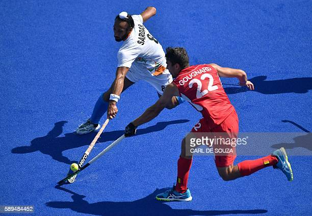 India's Sardar Singh vies with Belgium's Simon Gougnard during the men's quarterfinal field hockey Belgium vs India match of the Rio 2016 Olympics...