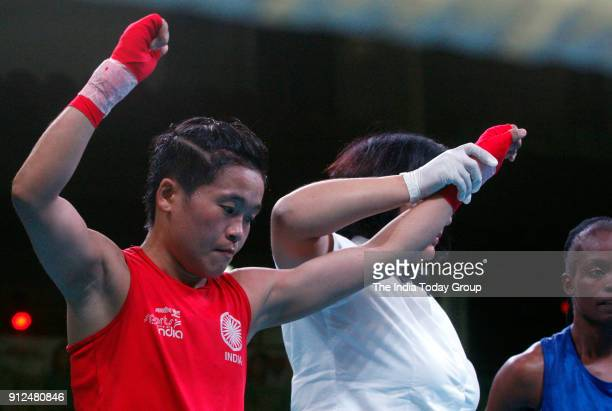 India's Sarjubala Devi in action against Cuba's Rabi Armando Martinez during their bout at India Open International Boxing tournament in New Delhi