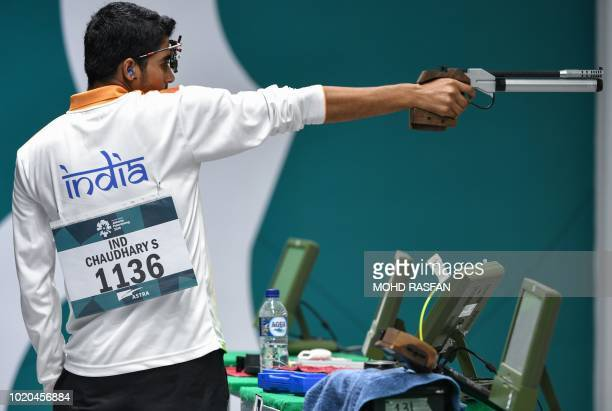 India's Saurabh Chaudhary competes in the men's 10m air pistol shooting final during the 2018 Asian Games in Palembang on August 21 2018