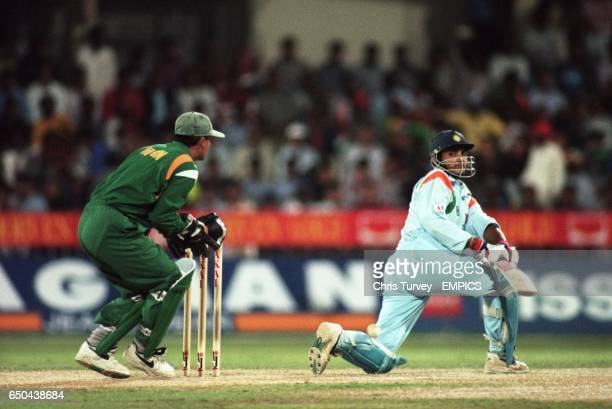 India's Saurav Ganguly sweeps the ball to leg watched by Pakistan wicketkeeper Moin Khan