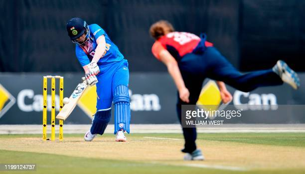 India's Shafali Verma plays a shot against the bowling of England's Katherine Brunt during their women's T20 international cricket match in Melbourne...