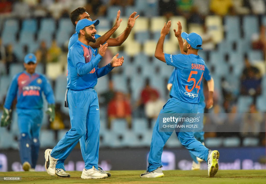India's Shardul Thakur and India's Suresh Raina celebrate after getting a wicket of South Africa's JJ Smuts during the second T20I cricket match between South Africa and India at Super Sport Park Stadium in Pretoria on February 21, 2018. / AFP PHOTO / Christiaan Kotze