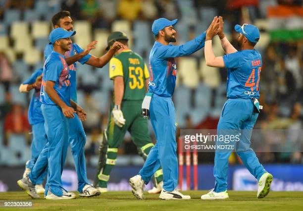 India's Shardul Thakur and India's Suresh Raina celebrate after getting a wicket of South Africa's JJ Smuts during the second T20I cricket match...