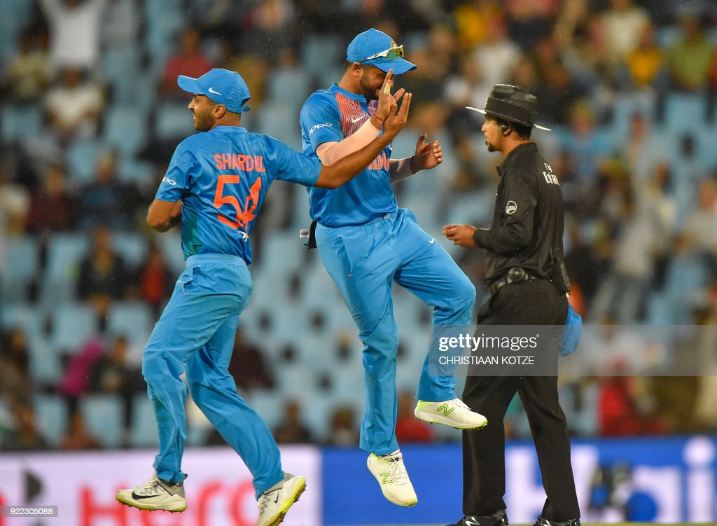 India's Shardul Thakur and India's Suresh Raina celebrate after getting a wicket during the second T20I cricket match between South Africa and India at Super Sport Park Stadium in Pretoria on February 21, 2018. / AFP PHOTO / Christiaan Kotze
