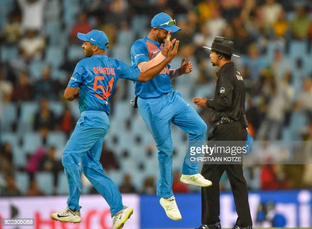 India's Shardul Thakur and India's Suresh Raina celebrate after getting a wicket during the second T20I cricket match between South Africa and India...