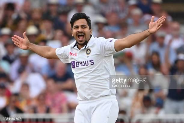 India's Shardul Thakur appeals successfully after trapping England's captain Joe Root LBW during play on the first day of the first cricket Test...