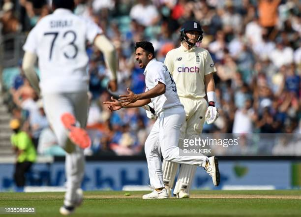 India's Shardul Thakur celebrates taking the wicket of of England's captain Joe Root during play on the fifth day of the fourth cricket Test match...