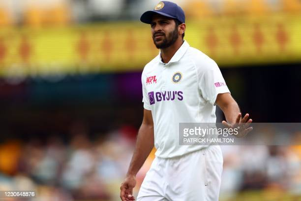 India's Shardul Thakur walks back to his fielding position on day four of the fourth cricket Test match between Australia and India at The Gabba in...
