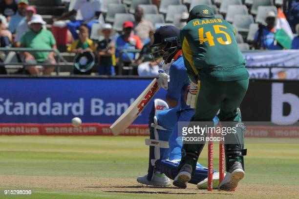 India's Shikar Dhawan bats during the One Day International cricket match between India and South Africa at Newland Stadium on February 7 in Cape...