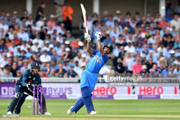 India's Shikar Dhawan is caught by England's Adil Rashid off the bowling of Moeen Ali for 40 runs during the One Day International cricket match...
