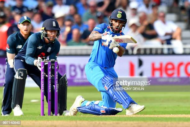 India's Shikar Dhawan plays a shot during the One Day International cricket match between England and India at Trent Bridge in Nottingham central...