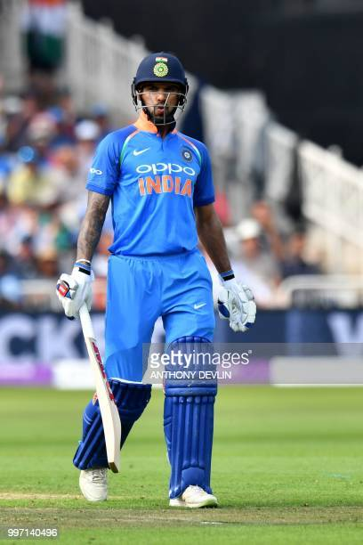 India's Shikar Dhawan reacts after losing his wicket during the One Day International cricket match between England and India at Trent Bridge in...