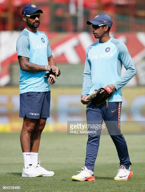 India's Shikhar Dhawan and Wriddhiman Saha take part in a training session of the Indian national cricket team at Supersport Park cricket ground on...