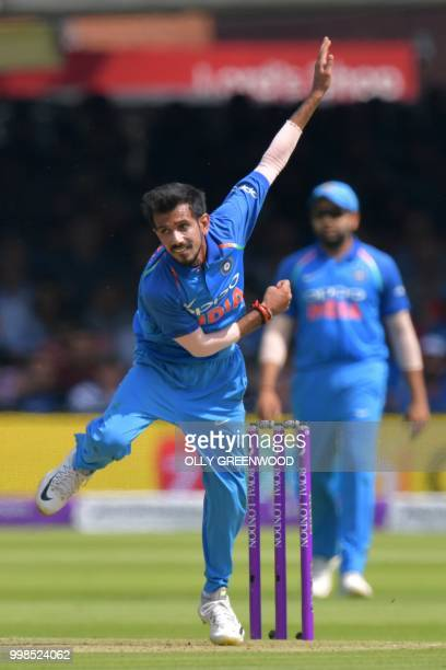 India's Shikhar Dhawan bowls during the second One Day International cricket match between England and India at Lord's Cricket Ground in London on...