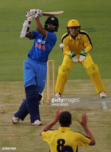 India's Shikhar Dhawan brings up his 50 during the T20 cricket match between India and a Western Australian XI in Perth on January 8 2016 AFP PHOTO /...