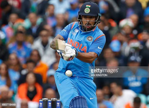 India's Shikhar Dhawan misstimes his swing and his hit by a ball during the ICC Champions Trophy match between India and Sri Lanka at The Oval in...