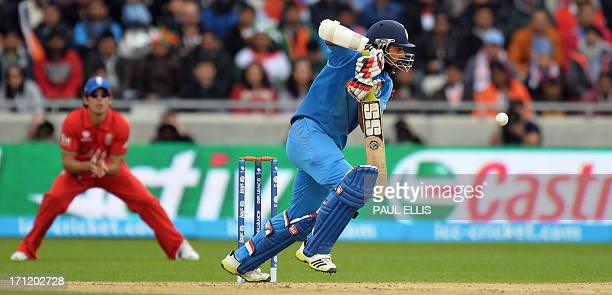 India's Shikhar Dhawan plays a shot during the 2013 ICC Champions Trophy Final cricket match between England and India at Edgbaston in Birmingham...