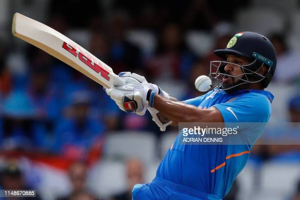 India's Shikhar Dhawan plays a shot during the 2019 Cricket World Cup group stage match between India and Australia at The Oval in London on June 9...