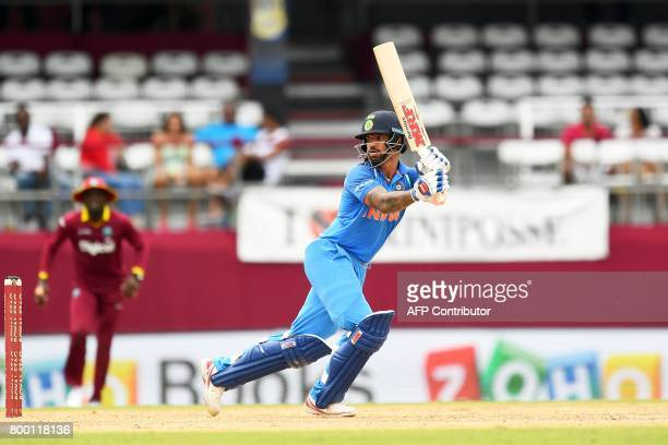 India's Shikhar Dhawan plays a shot during the first One Day International match between West Indies and India at the Queen's Park Oval in Port of...