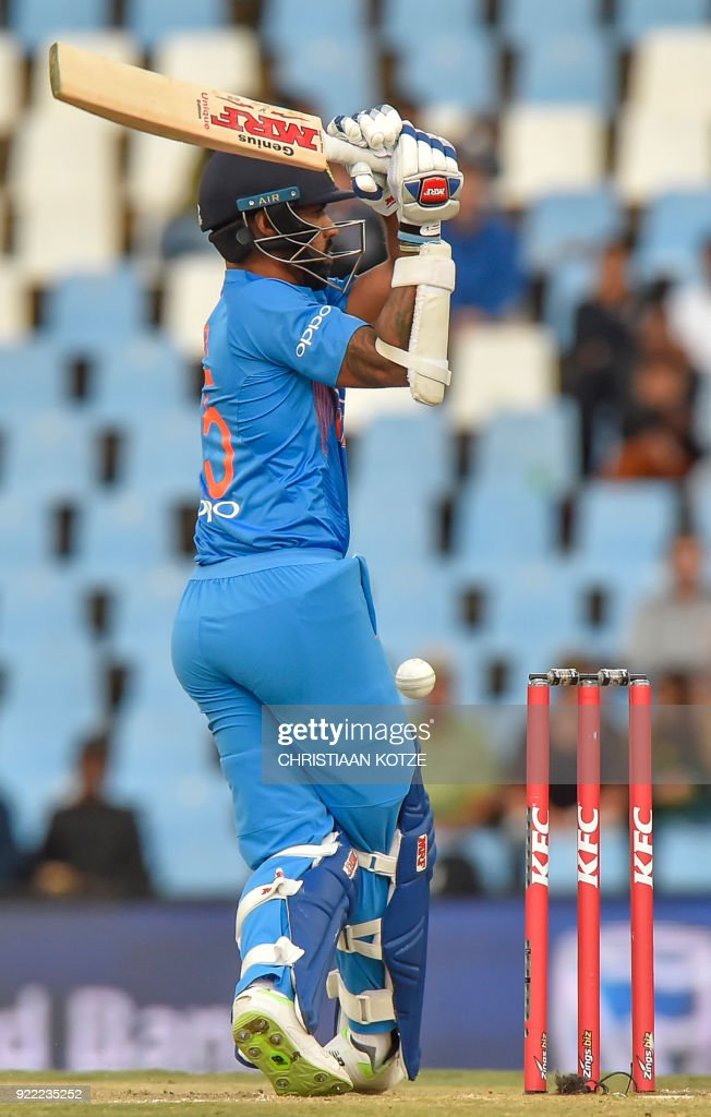 India's Shikhar Dhawan plays a shot during the second T20I cricket match between South Africa and India at Super Sport Park Stadium in Pretoria on February 21, 2018. / AFP PHOTO / Christiaan Kotze