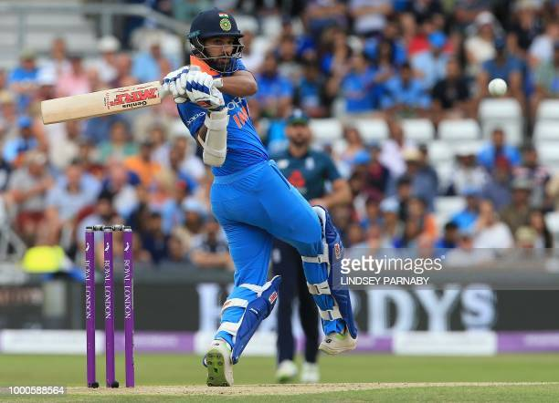 India's Shikhar Dhawan plays a shot during the third One Day International cricket match between England and India at Headingley Stadium in Leeds...