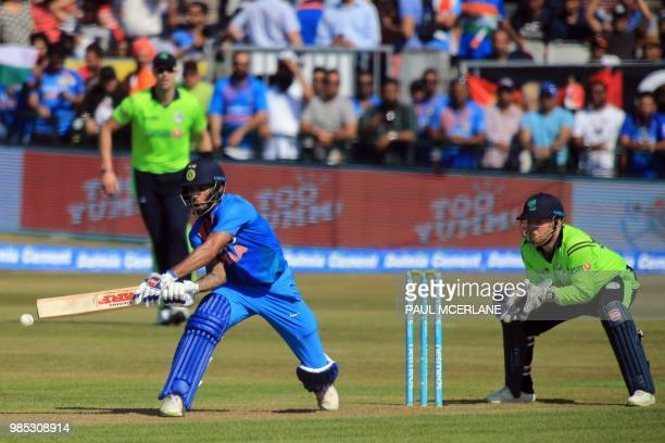 India's Shikhar Dhawan plays a shot during the Twenty20 International cricket match between Ireland and India at Malahide cricket club in Dublin on...