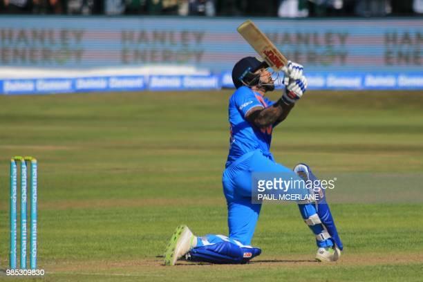 India's Shikhar Dhawan plays a shot during the Twenty20 International cricket match between Ireland and India at Malahide cricket club in Dublin on...
