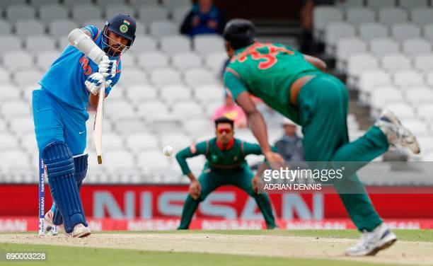 India's Shikhar Dhawan plays a shot for four runs off the bowling of Bangladesh's Rubel Hossain during the ICC Champions Trophy Warmup cricket match...