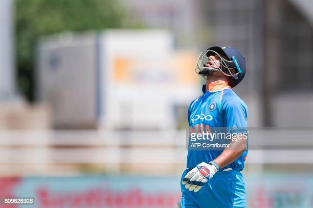 India's Shikhar Dhawan reacts after being caught out during the fifth One Day International match between West Indies and India at the Sabina Park...