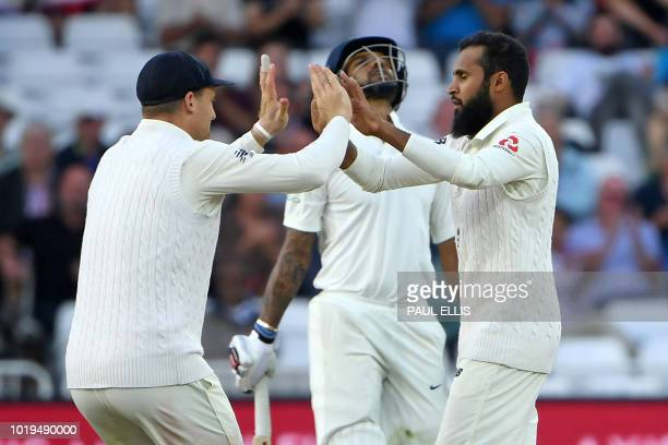 India's Shikhar Dhawan reacts after losing his wicket to England's Adil Rashid during play on the second day of the third Test cricket match between...