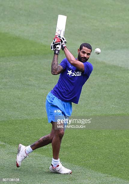 India's Shikhar Dhawan takes part in a team training session ahead of the second Twenty20 cricket match between Australia and India in Melbourne on...